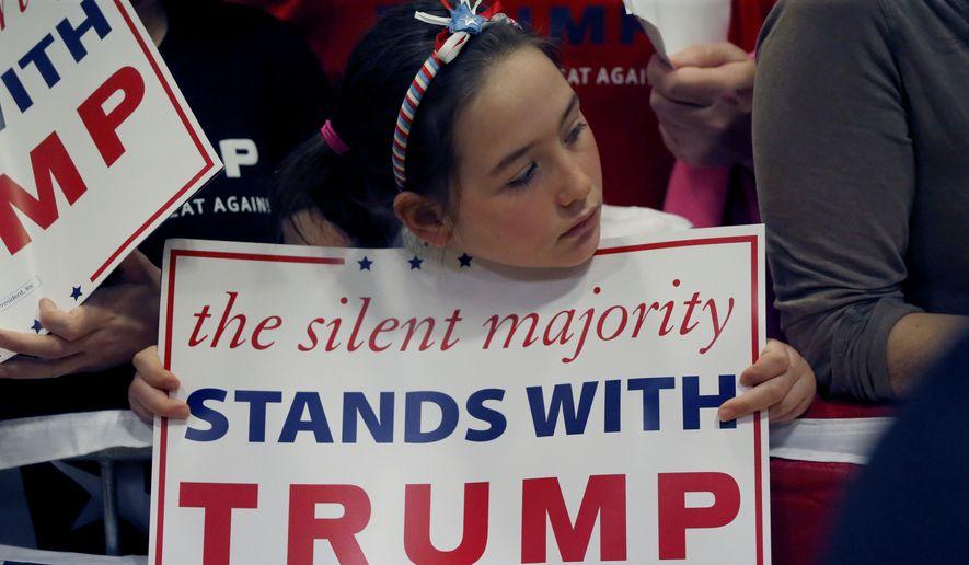 A young girl waits to see Republican presidential candidate, Donald Trump, after a rally at Nathan Hale High School, Sunday, April 3, 2016, in West Allis, Wis. (AP Photo/Charles Rex Arbogast)