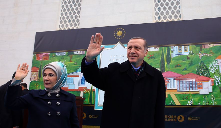 "Turkey's President Recep Tayyip Erdogan, flanked by his wife Emine Erdogan, waves as he arrives to inaugurate the Diyanet Islamic Cultural Center in Lanham, Maryland, Saturday, April 2, 2016. Erdogan has vowed to back Azerbaijan in the conflict with Armenia over the separatist region of Nagorno-Karabakh. During his visit to the United States, Erdogan told an Azerbaijani reporter that ""we will support Azerbaijan to the end."" The remarks were quoted by the presidency on Sunday.(Kayhan Ozer, Presidential Press Service, Pool via AP)"