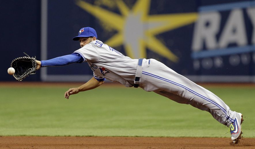 Toronto Blue Jays first baseman Chris Colabello makes a diving stop on a ground ball hit by Tampa Bay Rays' Corey Dickerson during the first inning of a baseball game Sunday, April 3, 2016, in St. Petersburg, Fla. Dickerson was out at first. (AP Photo/Chris O'Meara)