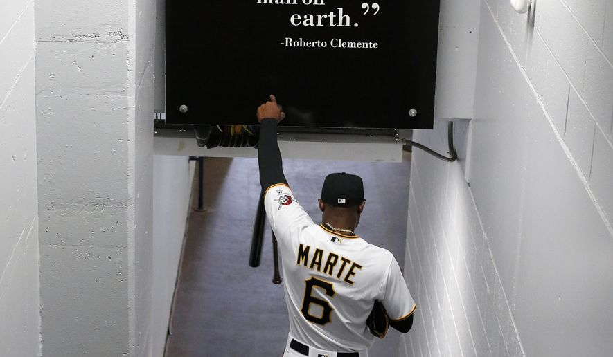 Pittsburgh Pirates' Starling Marte walks to the dugout before the first baseball game of the Major League season against the St. Louis Cardinals at PNC Park in Pittsburgh, Sunday, April 3, 2016. (AP Photo/Gene J. Puskar)