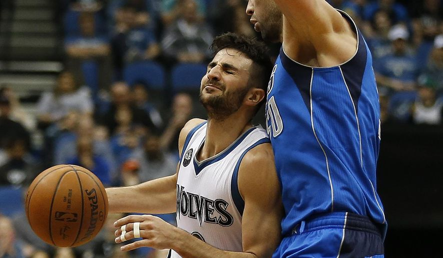Minnesota Timberwolves guard Ricky Rubio (9) reacts after being fouled by Dallas Mavericks center Salah Mejri (50) in the first half of an NBA basketball game Sunday, April 3, 2016, in Minneapolis. (AP Photo/Stacy Bengs)