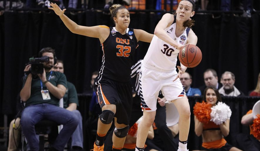Connecticut's Breanna Stewart (30) is defended by Oregon State's Deven Hunter (32) during the first half of a national semifinal game at the women's Final Four in the NCAA college basketball tournament Sunday, April 3, 2016, in Indianapolis. (AP Photo/AJ Mast)