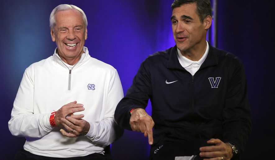 North Carolina head coach Roy Williams and Villanova head coach Jay Wright laugh during a CBS Sports Network interview for the NCAA Final Four tournament college basketball championship game Sunday, April 3, 2016, in Houston. Villanova and North Carolina will play in the championship game on Monday. (AP Photo/David J. Phillip)