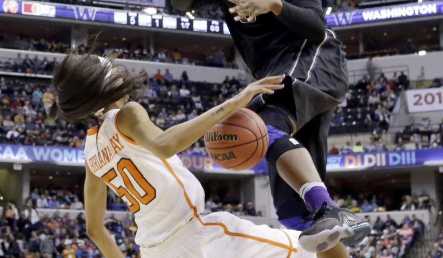 Washington's Chantel Osahor (0) is called for a charging foul against Syracuse's Briana Day (50) during the first half of a national semifinal game at the women's Final Four in the NCAA college basketball tournament Sunday, April 3, 2016, in Indianapolis. (AP Photo/Michael Conroy)