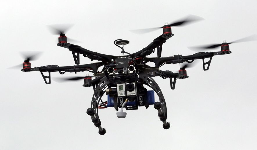 A commercial drone. (AP Photo/Rick Bowmer) ** FILE **