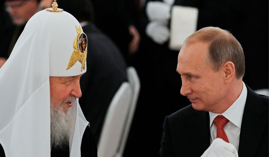 Russian President Vladimir Putin (right) and Russian Orthodox Church Patriarch Kirill remain cozy as Russians are jailed for pro-atheist statements, and anti-church sentiments slowly rise. (Associated Press)