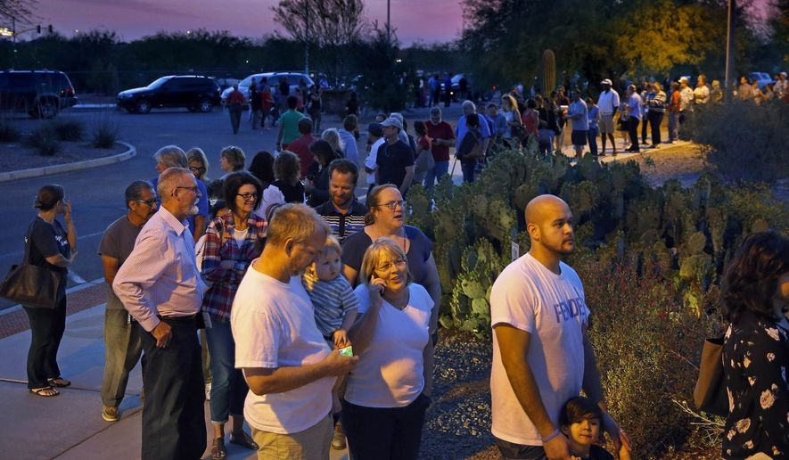People waited in line for hours to vote in Maricopa County, Arizona's botched primary March 22. With significantly fewer polling places than in previous primaries in the Grand Canyon State, those still open in metro Phoenix saw voters in line after midnight. (The Arizona Republic via Associated Press)