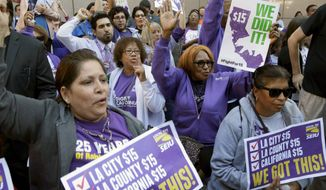 Workers rally outside the Ronald Reagan State Building in Los Angeles after California's Gov. Jerry Brown signed a bill creating highest statewide minimum wage. (Associated press photographs)