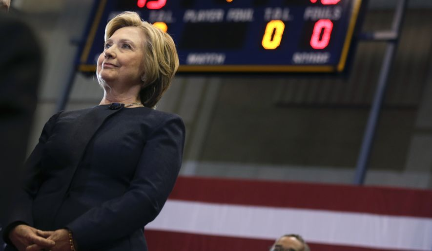 Democratic presidential candidate Hillary Clinton listens as she is introduced during a rally at Cohoes High School on Monday, April 4, 2016, in Cohoes, N.Y. (AP Photo/Mike Groll)