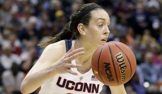 Connecticut forward Breanna Stewart (30) takes the ball against Oregon State, during the second half of a national semifinal game at the women's Final Four in the NCAA college basketball tournament Sunday, April 3, 2016, in Indianapolis. (AP Photo/Michael Conroy)
