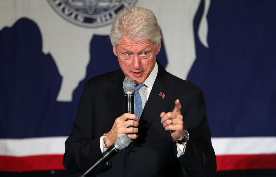 Former President Bill Clinton speaks to a crowd, Monday, April 4, 2016, as he campaigns for his wife, Democratic presidential candidate Hillary Clinton, at the Cheyenne-Kiwanis Community House in Cheyenne, Wyo. Bill Clinton touched on a variety of topics, including health care, education and energy policies. (Blaine McCartney/Wyoming Tribune Eagle via AP)