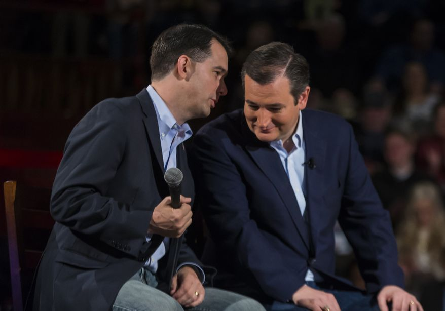 Republican presidential candidate, Sen. Ted Cruz, right, R-Texas, shares a moment with Wisconsin Gov. Scott Walker at a campaign stop, Monday, April 4, 2016, in Madison, Wis. (AP Photo/Andy Manis)