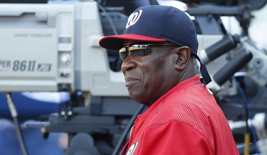 Washington Nationals manager Dusty Baker (12) looks on from the dugout during a baseball  game against the Atlanta Braves Monday, April 4, 2016, in Atlanta. (AP Photo/John Bazemore)