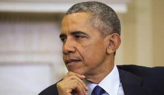 President Barack Obama listens as NATO Secretary General Jens Stoltenberg speaks in the Oval Office of the White House in Washington, Monday, April 4, 2016. (AP Photo/Jacquelyn Martin)