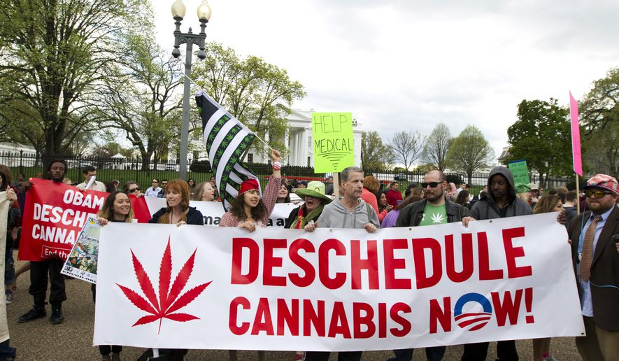 Demonstrators calling for the legalization of marijuana outside of the White House, in Washington, Saturday, April 2, 2016. They are demanding Obama use his authority to stop marijuana arrests and pardon offenders. (AP Photo/Jose Luis Magana) ** FILE **