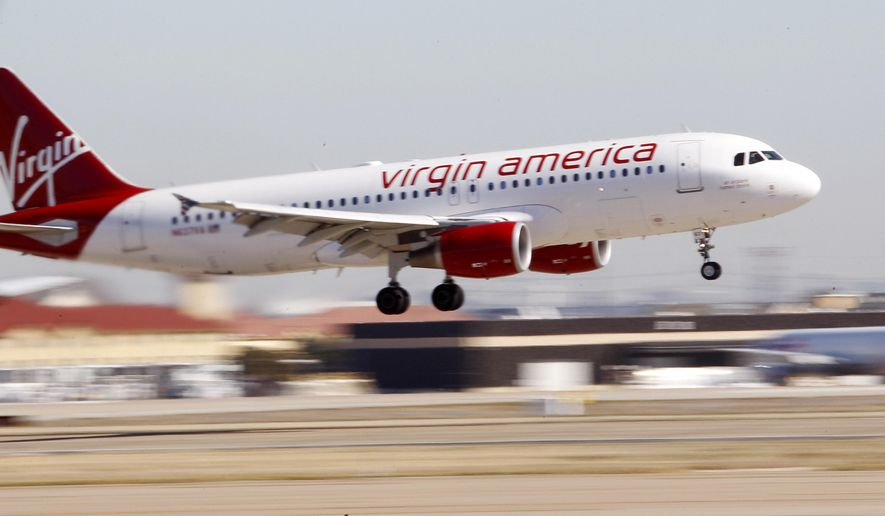 In this Dec. 1, 2010, file photo, Virgin America's inaugural flight between Los Angeles and Dallas Fort Worth International Airport comes in for a landing in Grapevine, Texas. Alaska Air Group Inc. is buying Virgin America in a deal worth more than $2 billion, creating a powerhouse airline with an expanded West Coast presence. (AP Photo/LM Otero, File)