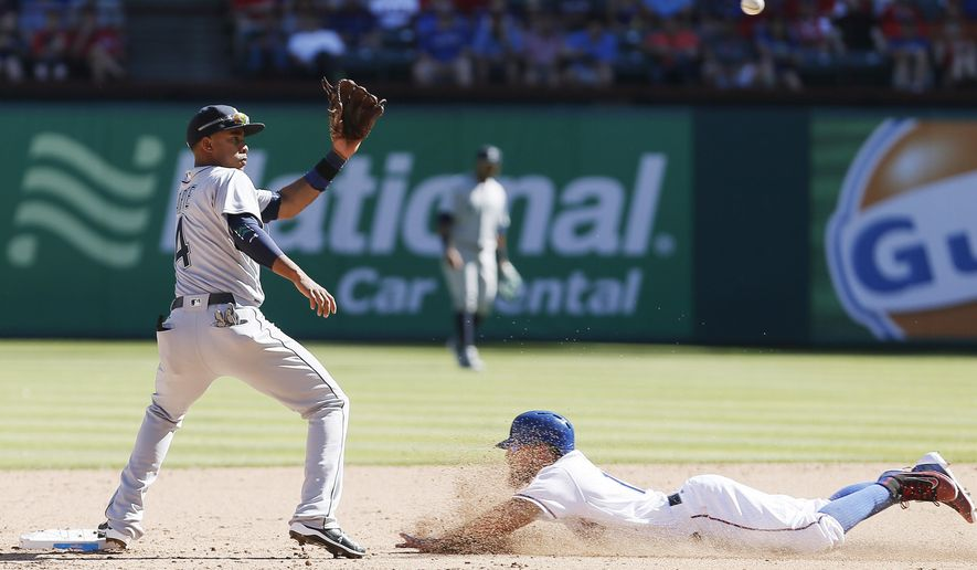 Texas Rangers' Rougned Odor, right, steals second base as Seattle Mariners shortstop Ketel Marte (4) awaits the throw from home during the fifth inning of a baseball game, Monday, April 4, 2016, in Arlington, Texas. (AP Photo/Brandon Wade)