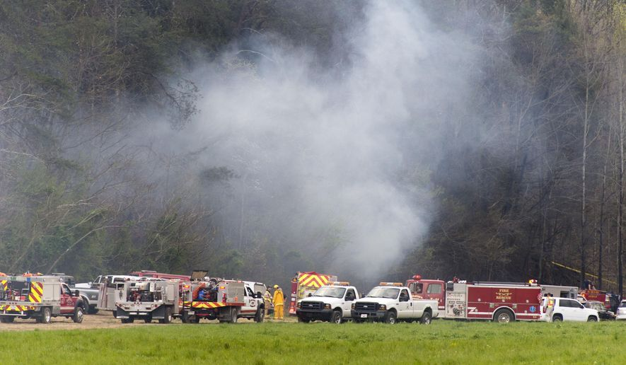 Emergency vehicles respond to the scene of a fatal helicopter crash, Monday, April 4, 2016, in Pigeon Forge, Tenn. A sightseeing helicopter crashed near the Great Smoky Mountains National Park in eastern Tennessee, officials said. (Saul Young/Knoxville News Sentinel via AP) MANDATORY CREDIT