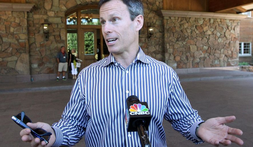 FILE- In this July 9, 2013, file photo, Chairman of Walt Disney Parks and Resorts, Thomas Staggs talks with reporters after arriving at the Allen & Company Sun Valley Conference in Sun Valley, Idaho. Staggs, the presumed front-runner to replace Bob Iger as CEO of The Walt Disney Co., is leaving the company next month. The surprise announcement Monday, April 4, 2016, means the company will have to look further for Iger's successor after he steps down about two years from now.(AP Photo/Rick Bowmer, File)