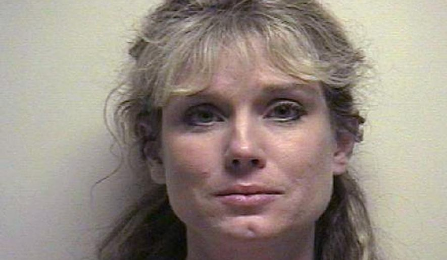 This undated photo provided by the Utah County Jail shows Elizabeth Craig. The Utah Supreme Court is set to hear from Craig, a former Miss Utah who says she was wrongly arrested on bogus allegations that she stole from her former employer, the skin-care company Nu Skin. The city of Provo is set to ask the high court Monday to toss out the lawsuit from Craig, who says she legally selling surplus product donated by the company for her charity. The charges were dropped in 2010. (Utah County Jail via AP)