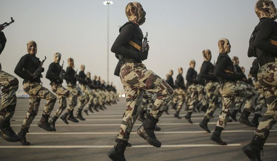 In this Sept. 17, 2015, photo, Saudi security forces take part in a military parade in preparation for the annual Hajj pilgrimage in Mecca, Saudi Arabia. (AP Photo/Mosa'ab Elshamy) **FILE**