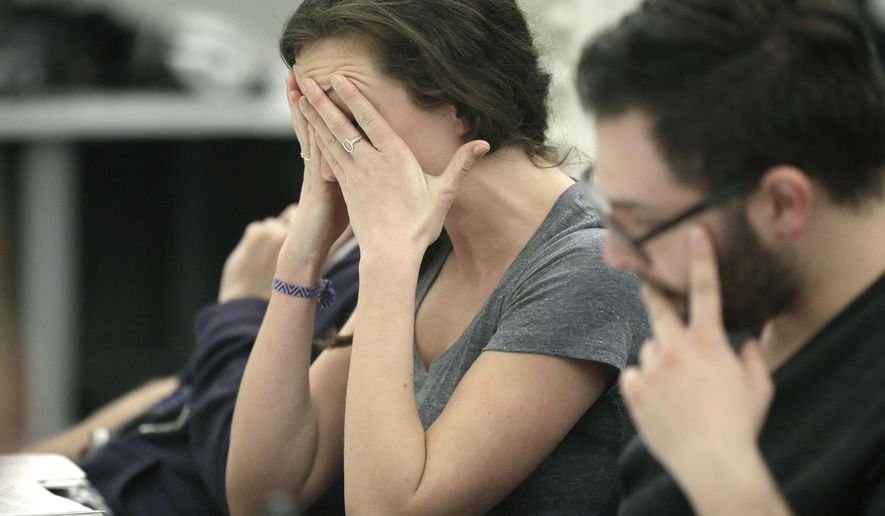 """In this Wednesday, March 23, 2016 photo, actor Gigi Watson, of Cambridge, Mass., left, performs in the role of Boston Marathon bombing survivor Lee Ann Yanni, as Joey Frangieh, of Westwood, Mass., right, co-creator of the play """"Finish Line"""" reads along during a rehearsal of the play in Boston. The stage production, that draws from dozens of interviews with survivors, runners, doctors, first responders and others, is to open April 7, 2016. (AP Photo/Steven Senne)"""