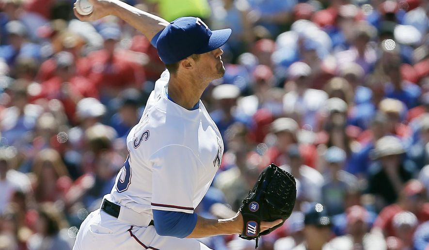 Texas Rangers starting pitcher Cole Hamels throws during the first inning of a baseball game against the Seattle Mariners, Monday, April 4, 2016, in Arlington, Texas. (AP Photo/Brandon Wade)