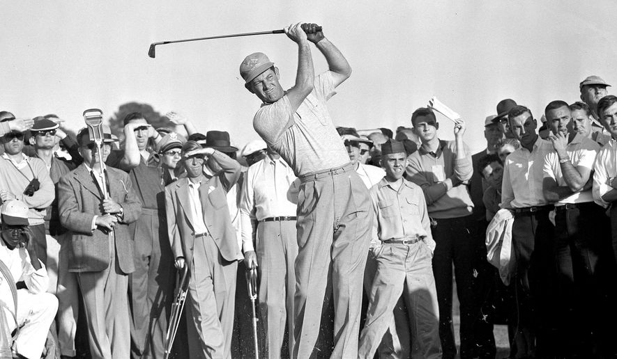 FILE - In this April 8, 1955 file photo, Cary Middlecoff takes a shot from the 15th fairway during second round of Masters Golf Tournament. Middlecoff won the Masters by seven shots, which at the time was the largest margin of victory. (AP Photo/Horace Cort, File)