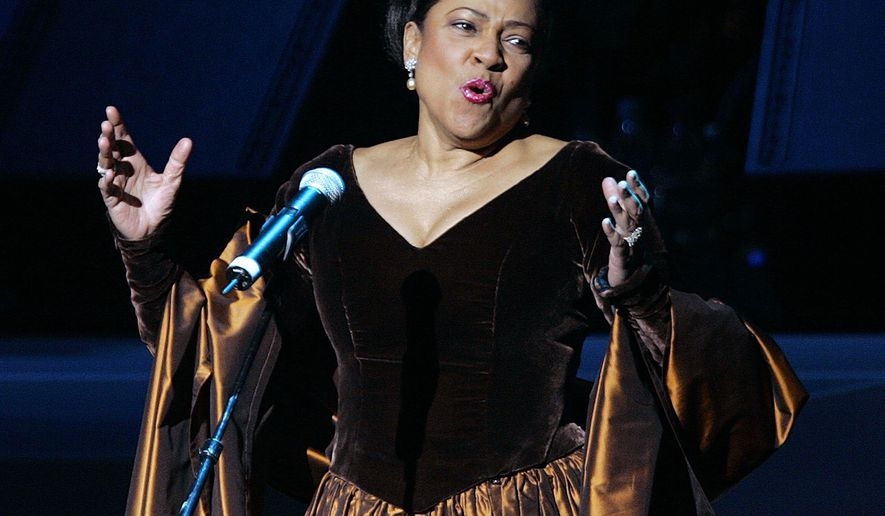 "FILE - In this Nov. 19, 2005 file photo, opera star Kathleen Battle performs during the grand opening gala celebration for the Muhammad Ali Center in Louisville, Ky. Battle is returning to the Metropolitan Opera, 22 years after the company fired her citing ""unprofessional actions."" Battle, who turns 68 in August, will sing a recital on Nov. 13, 2016, titled ""Underground Railroad _ A Spiritual Journey,"" the company said Monday, April 4, 2016.  (AP Photo/Ed Reinke, File)"