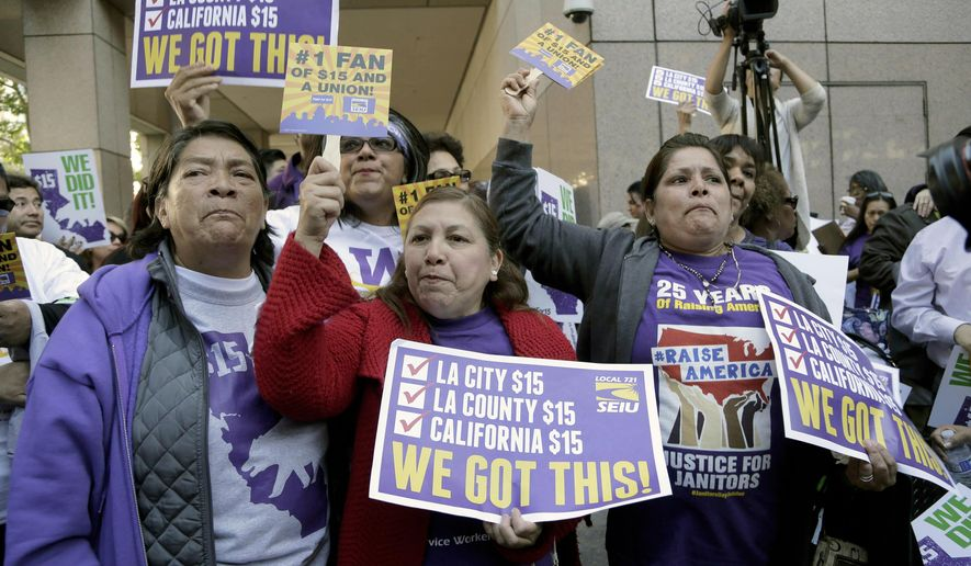 Workers rally outside the Ronald Reagan State Building in Los Angeles after California's Gov. Jerry Brown signed a bill creating highest statewide minimum wage at $15 an hour by 2022 in Los Angeles, Monday, April 4, 2016. California and New York acted Monday to gradually push their statewide minimum wages to $15 an hour, the highest level in the nation. (AP Photo/Nick Ut)