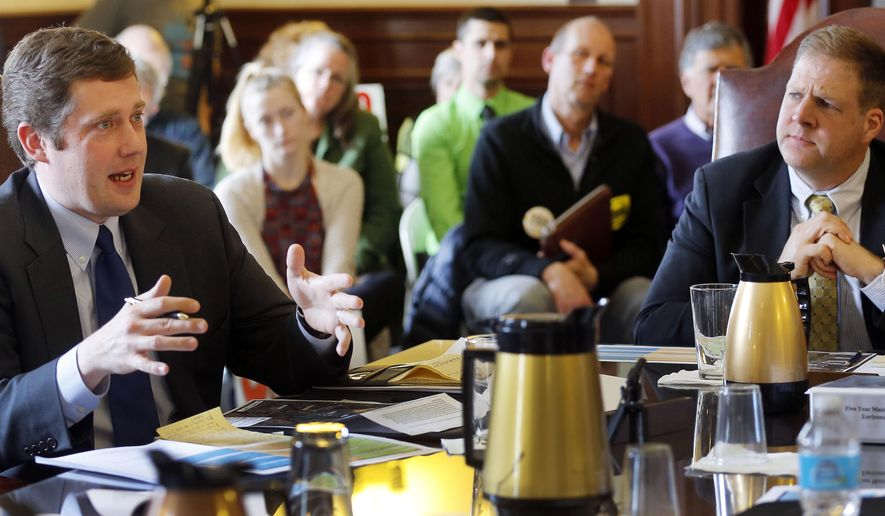 In this March 30, 2016 photo, gubernatorial hopefuls Colin Van Ostern, left, a Democrat and Chris Sununu a Republican, talk at the Governor and Council information hearing about the Mount Sunapee expansion plan in Concord, N.H. A yearslong effort to expand a ski mountain will finally get an up-or-down vote and, with it, force two gubernatorial candidates to pick sides in an emotional and unique New Hampshire issue. The Executive Council is set to vote Wednesday, April 6, 2016, on whether to approve the expansion, which includes more lifts and trails, at Mount Sunapee Resort. (AP Photo/Jim Cole)