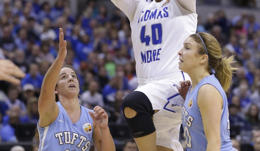 Thomas More's Sydney Moss, center, passes between Tufts' Lauren Dillon (11) and Josie Lee during the first half of the championship game at the women's NCAA Division III basketball tournament in Indianapolis, Monday, April 4, 2016. (AP Photo/Michael Conroy)
