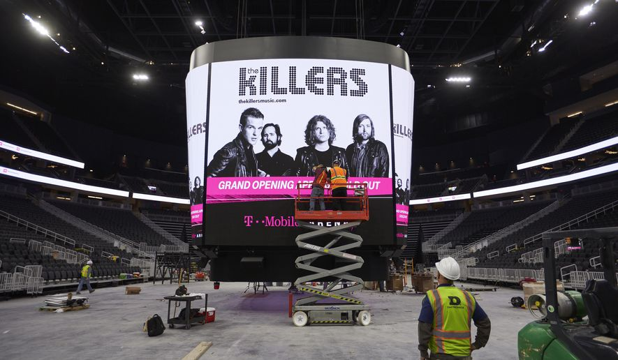 In this March 28, 2016 photo, workers finish construction on the scoreboard inside of the T-Mobile Arena in Las Vegas. The latest multi-million dollar development on the Las Vegas Strip features a leafy outdoor pedestrian area, 20,000 seat arena and small theater. The arena is scheduled to open April 6. (AP Photo/John Locher)