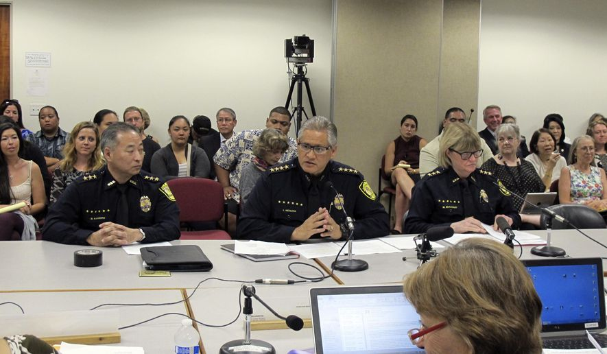 FILE- In this Sept. 30, 2014, file photo, Honolulu Police Chief Louis Kealoha, center, addresses Hawaii lawmakers as Deputy Chief Dave Kajihiro, left, and Deputy Chief Marie McCauley, right, and state Sen. Rosalyn Baker, foreground, listen during hearing at the state Capitol in Honolulu. A grand jury is looking into allegations of civil rights abuses and corruption by the Honolulu Police Department that emerged from a theft case involving the police chief's mailbox, a federal public defender said Monday, April 4, 2016. (AP Photo/Jennifer Sinco Kelleher, File)