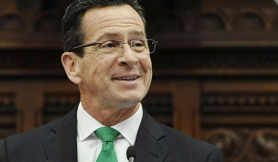 FILE - In this Jan. 7, 2015, file photo, Connecticut Gov. Dannel P. Malloy smiles during the State of the State address to a joint session of the legislature in the House Chambers at the Capitol in Hartford, Conn. Malloy was named Monday, April 4, 2016, as recipient of the annual John F. Kennedy Profile in Courage Award for supporting the resettlement of Syrian refugees in the U.S. following the November 2015 Paris terrorist attacks. Malloy personally welcomed a Syrian family to Connecticut after Indiana officials objected to their resettlement there. He is scheduled to receive the award in Boston on May 1. (AP Photo/Jessica Hill, File)