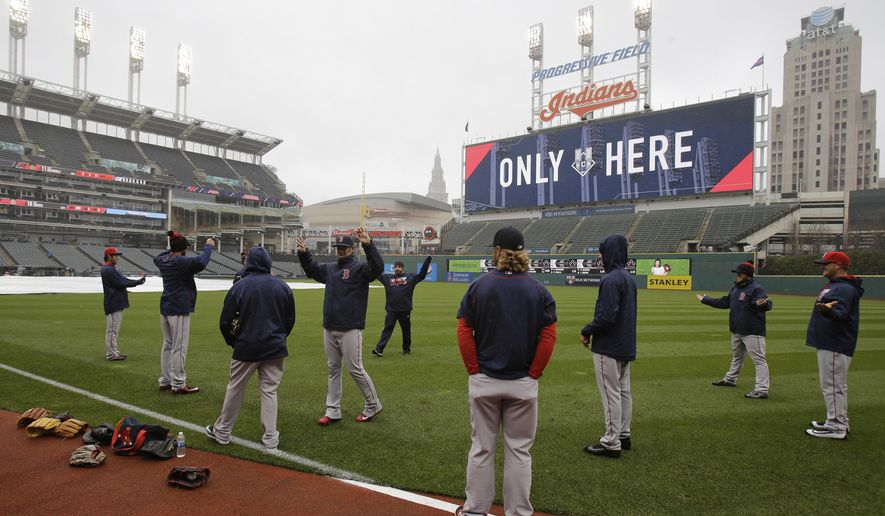 Members of the Boston Red Sox stretch before a baseball game between the Red Sox and the Cleveland Indians, Monday, April 4, 2016, in Cleveland. (AP Photo/Tony Dejak)