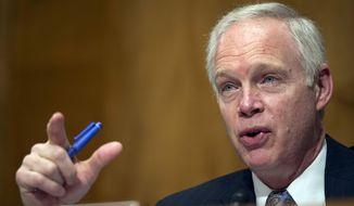 Sen. Ron Johnson, R-Wis., speaks on Capitol Hill in Washington, in this Feb. 2, 2016, file photo. (AP Photo/Cliff Owen, file)