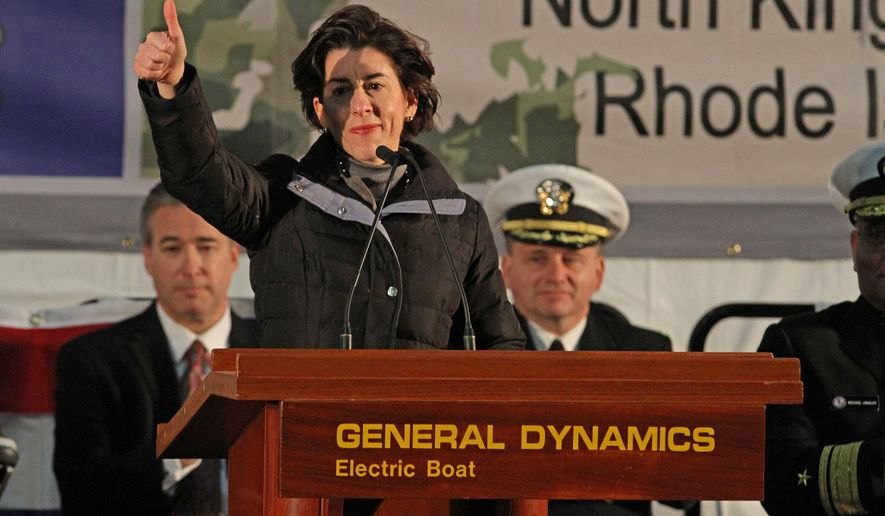 Rhode Island Gov. Gina Raimond gives the thumbs up to the workers at Electric Boat while attending the keel laying for the Virginia-class submarine South Dakota, Monday, April 4, 2016, in North Kingstown, R.I.  (Steve Szydlowski/The Providence Journal via AP)  NO SALES