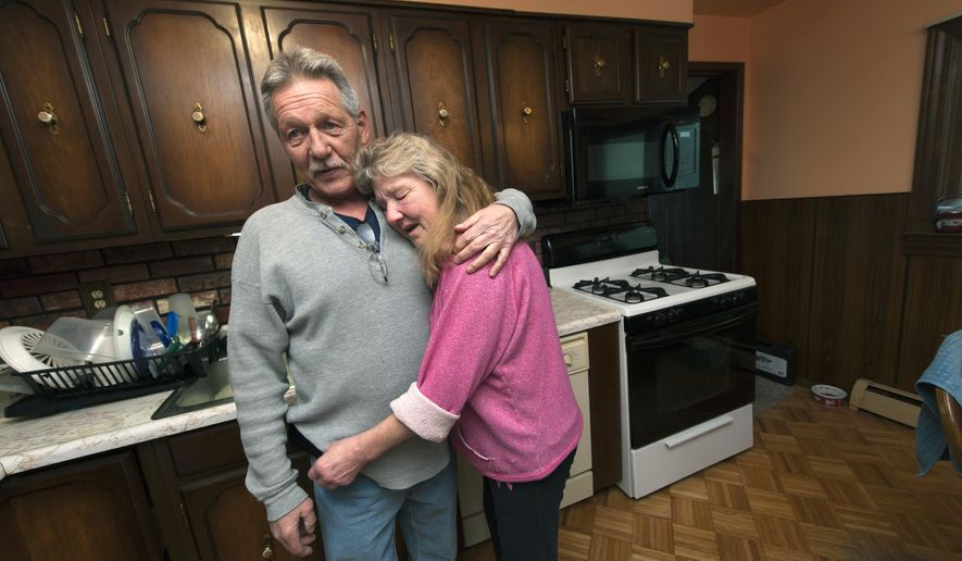 In a Feb. 22, 2016 photo, Ron and Berni King  in their Westland, Mich.,  home. The county foreclosed on Bernice and Ron King's Westland home last year over a $3,000 unpaid tax bill. The Kings said they didn't realize they were in danger of losing their home until days before it was sold at auction. (David Guralnick/The Detroit News via AP)