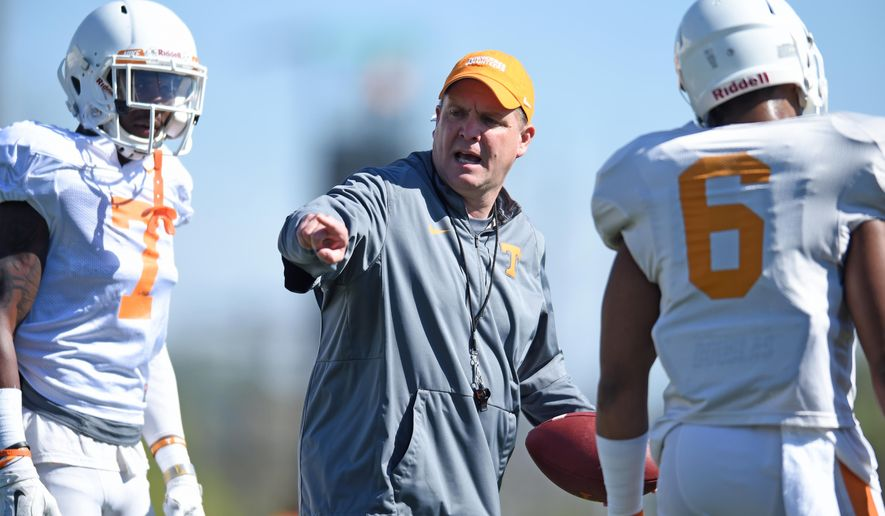 In this March 29, 2016, photo, Tennessee defensive coordinator Bob Shoop instructs defensive backs Rashaan Gaulden, left, and Todd Kelly Jr. during spring NCAA college football practice in Knoxville, Tenn. New Tennessee defensive coordinator Shoop has wasted no time making an impression on his new team, even as he spends spring practice working with a defense missing several of its top performers due to injuries.  (Adam Lau/Knoxville News Sentinel via AP)