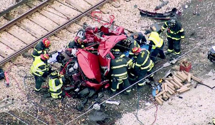 This frame grab taken from a video by WLS-TV in Chicago shows emergency personnel at the scene where a train struck a car Monday, April 4, 2016, in Skokie, Ill., killing at least one person and injuring several others. Investigators believe the vehicle drove through a grade crossing before the collision. (WLS-TV via AP) TV OUT