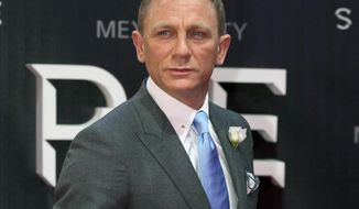 "FILE - In this Nov. 2, 2015 file photo, actor Daniel Craig walks the red carpet at the regional premiere of the latest James Bond film, ""Spectre,"" in Mexico City. (AP Photo/Rebecca Blackwell, File)"