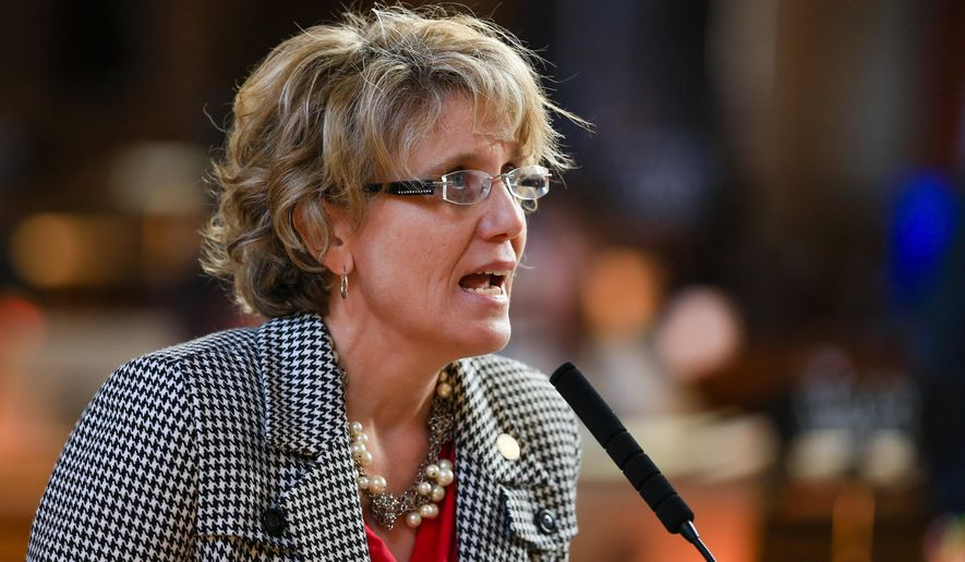 Nebraska state Sen. Sue Crawford, of Bellevue, speaks during a debate in Lincoln, Neb., Monday, April 4, 2016, on a bill that would reinstate the winner-take-all system when awarding electoral votes in presidential races. Nebraska awards its electoral votes by congressional district. (AP Photo/Nati Harnik)