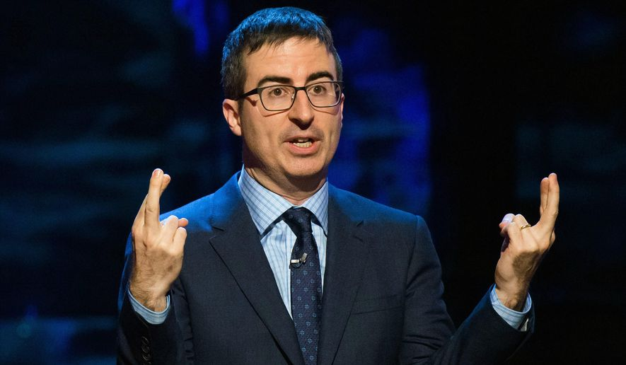 "FILE - In this Feb. 28, 2015 file photo, John Oliver speaks at Comedy Central's ""Night of Too Many Stars: America Comes Together for Autism Programs"" in New York. HBO's Oliver says his show has purchased two high-priced Legends Suite seats behind home plate for the opening three-game series at Yankee Stadium this week and will sell them for 25 cents each to poorly dressed fans. (Photo by Charles Sykes/Invision/AP, File)"