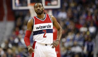 Washington Wizards guard John Wall (2) pauses on the court during the first half of an NBA basketball game against the Atlanta Hawks, Wednesday, March 23, 2016, in Washington. (AP Photo/Alex Brandon)