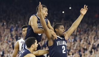 Villanova forward Kris Jenkins (2) celebrates with teammates after the NCAA Final Four tournament college basketball championship game against North Carolina Monday, April 4, 2016, in Houston. Villanova won 77-74. (AP Photo/Eric Gay)