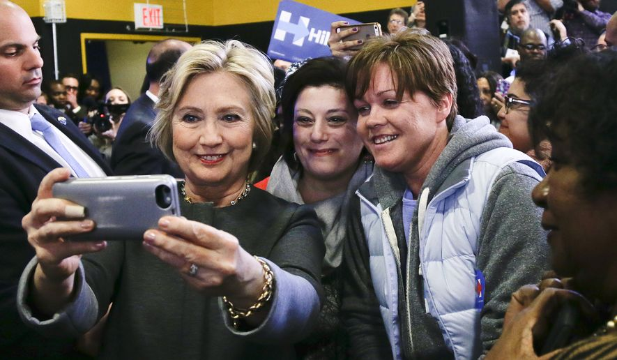 Democratic presidential candidate Hillary Clinton takes a selfie with supporters during a campaign stop, Tuesday, April 5, 2016, in New York. (AP Photo/Julie Jacobson)
