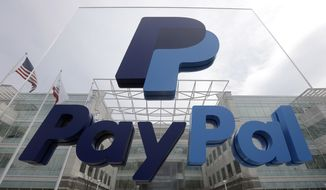This March 10, 2015, file photo, shows signage outside PayPal's headquarters in San Jose, Calif. PayPal said on Tuesday, April 5, 2016,  it's canceling plans to bring 400 jobs to North Carolina after lawmakers passed a law that restricts protections for lesbian, gay, bisexual and transgender people. (AP Photo/Jeff Chiu, File)