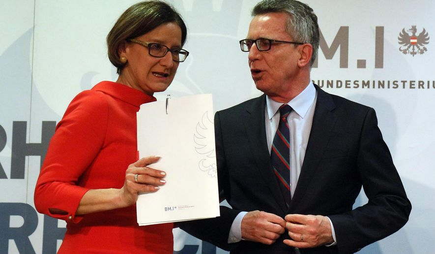 Austrian Interior Minister Johanna Mikl-Leitner , left, talks with German Interior Minister Thomas de Maiziere, after a  press conference following  a meeting  in Vienna, Austria, Tuesday, April 5, 2016. (AP Photo/Ronald Zak)