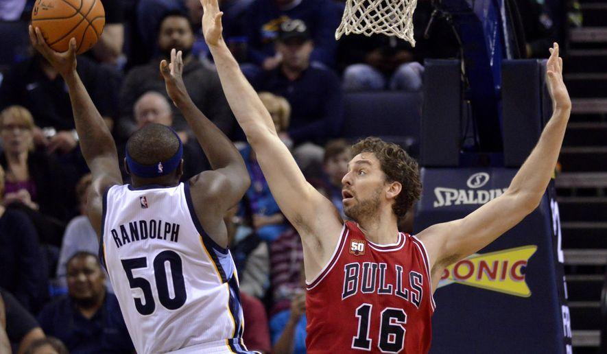 Memphis Grizzlies forward Zach Randolph (50) shoots against Chicago Bulls center Pau Gasol (16) during the first half of an NBA basketball game Tuesday, April 5, 2016, in Memphis, Tenn. (AP Photo/Brandon Dill)
